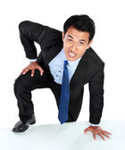 Portrait of businessman climb the wall — Stock Photo
