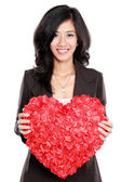 Business woman with red heart — Stock Photo