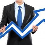 Portrait of businessman holding chart arrow sign — Stock Photo #41020641