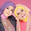 Two beautiful moslem woman having fun together — Stock Photo #41021537