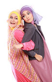 Two beautiful moslem woman having fun together — Foto Stock