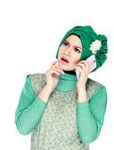 Woman with head scarf calling by phone — 图库照片