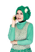Woman with head scarf calling by phone — Stock Photo