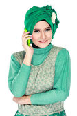 Asian woman with head scarf calling by mobile phone — Stock Photo