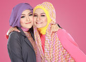Two beautiful moslem woman having fun together — Stock Photo