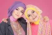 Two beautiful moslem woman having fun together — Стоковое фото