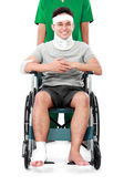 Male with broken arm and foot using wheel chair — Stock Photo