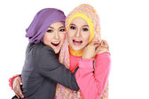 Two beautiful moslem woman having fun together — Stok fotoğraf