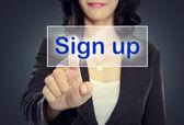 Woman push to Sign Up button — Stock Photo