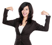 Excited businesswoman raised her hands showing strong concept — Foto Stock
