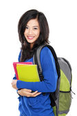 Young happy student carrying books — Fotografia Stock