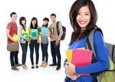 Female student with a group of people at the background — Stock Photo