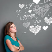 Beautiful girl looking up thinking of falling in love — Stock Photo