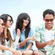 Group Friends Enjoying Beach Holiday together with tablet pc — Stock Photo