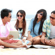 Group Friends Enjoying Beach Holiday together with tablet pc — Stock Photo #44481181