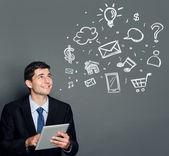 Homme d'affaires avec tablet pc en levant au concept multimédia — Photo