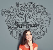 Woman smiling thinking of her summer vacation — Stock Photo