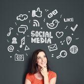 Woman with Hand drawn illustration of social media concept — Stock Photo