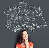 Vrouw op zoek denken van het kopen van of winkelen iets — Stockfoto