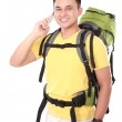 Male hiker with backpack using mobile phone — Stock Photo #46640871