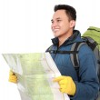 Young male hiking with backpack and map — Stock Photo #46640895