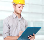 Foreman on building site with hard hat — Stock Photo