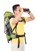 Hiking man tourist looking with binoculars — Stock Photo