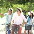 Friends having fun riding bicycle together — Stock Photo #47190739