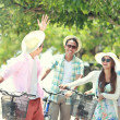 Friends having fun riding bicycle together — Stock Photo #47190813