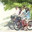 Friends having fun riding bicycle together — Stock Photo #47190899