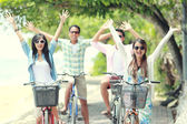 Friends having fun riding bicycle together — Stock Photo