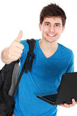 Young male student with laptop showing thumb up — Stock Photo