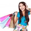 Young happy smiling woman with shopping bags — Stock Photo #47213361