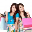 Two young woman happy holding shopping bags — Stock Photo #47213411