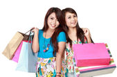 Two young woman happy holding shopping bags — Stock Photo