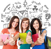 Female student together showing thumbs up — Stock Photo