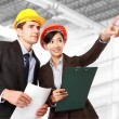Male and female architect at construction site — Stock Photo #48850091