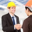 Shaking hands at construction site — Stock Photo #48850157