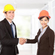 Shaking hands at construction site — Stock Photo #48850167