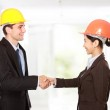 Shaking hands at construction site — Stock Photo #48850171
