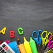 School supplies on blackboard background — Stock Photo #48858693