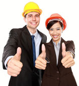 Two standing workers showing thumbs up — Stock Photo