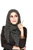 Woman with black scarf looking up to copy space — Stock Photo