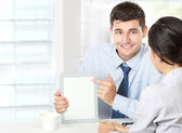 Business partners using touchpad at meeting — Stock Photo