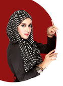 Fashion portrait of young beautiful muslim woman with black scar — Stock Photo