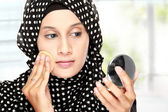 Woman with cotton pad applying face powder — Stock Photo