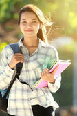 Young woman with bag and books — Stock Photo