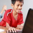 Kid using laptop — Stock Photo #50000227