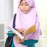 Muslim kid student reading book — Stock Photo #50026971