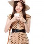Rero asian woman smiling using cellphone — Stock Photo #51269153